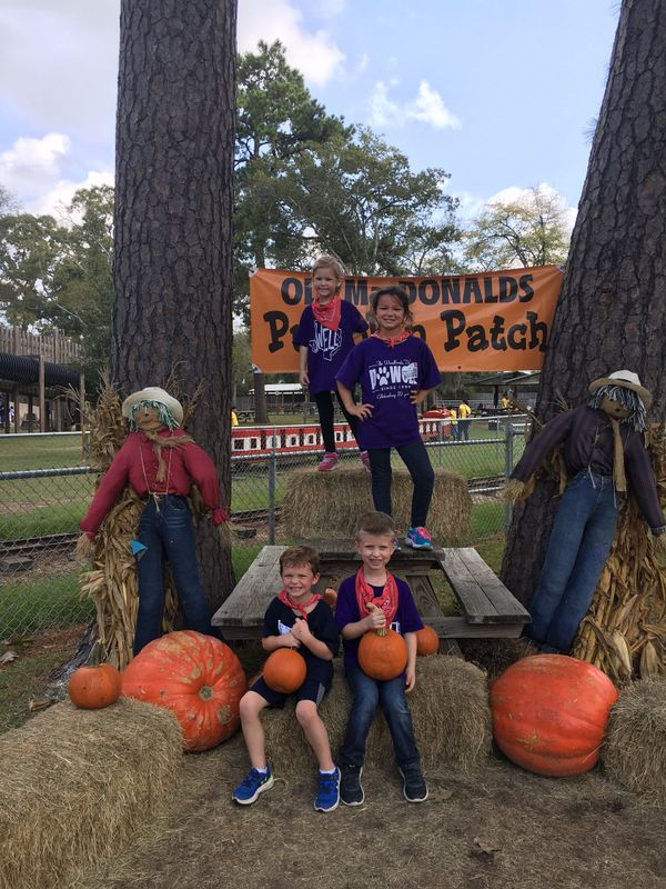 Four students at Old Mac Donalds Pumpkin Patch